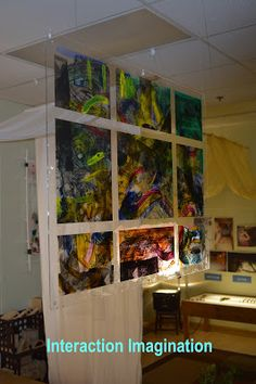 Interaction Imagination: Painting on plastic and hanging it to allow pools of light- Boulder Journey School ≈ ≈