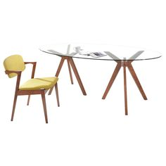This sleek, modern dining table will define your dinner area with impressive style. It has a clear glass top supported by a two unique wooden tripod legs that you will love eating and entertaining around.