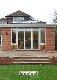 XACT Aluminium Roof Lantern, Bifold Doors, Bespoke Gutter supplied and installed on a traditional orangery style rear extension on a property in Witley, near Godalming.