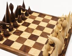 Full piece chess set and board. Hand carved pieces. Black Walnut wood and Sugar Maple wood.