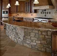 Love this stone kitchen bar - would be nice in a cabin. Stone Kitchen Island, Stone Island, Rock Island, Kitchen Islands, Island Bar, Big Island, Country Kitchen Island, Western Kitchen, Island Bench