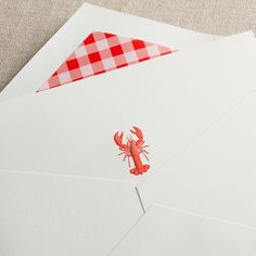 Never find yourself in a pinch—a set of notes on hand for correspondence is always necessary. Engraved in red and paired with our red and white gingham envelope lining, our lobster note is perfect for a message from the Cape or an invitation to the beach home.