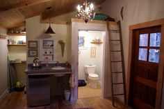 Tiny wonderfully crafted Mendocino cottage with recycled fir floors, Pottery Barn chandelier, handmade ladder to sleep loft - also a queen bed and flat screen TV on other side.