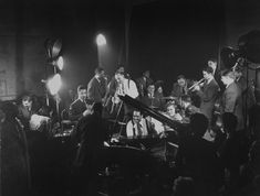Duke Ellington at the piano as Dizzy Gillespie (seated behind Ellington) and others swing, 1943 Gjon Mili—Time & Life Pictures/Getty Images