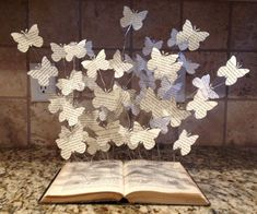 Book Art Paper Butterflies Book Art Sculpture Book Decorations Butterfly Books Book Lover Gift Paper Artwork Visual Art The beautiful Butterfly Book in the picture is one that I enjoyed creating for a local art competition. After winning sev Butterfly Books, Paper Butterflies, Paper Flowers, Butterfly Artwork, Butterfly Mobile, Origami Flowers, Art Flowers, Butterfly Decorations, Book Decorations