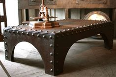 Industrial Coffee Table. Riveted table, one of my favorite! #LaBoutiqueVintage