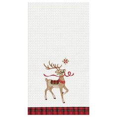 Waffle weave kitchen towel with embroidered reindeer and tartan plaid trim.