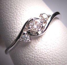 3 sparkling white diamonds set in 14K white gold ~ beautiful wedding ring