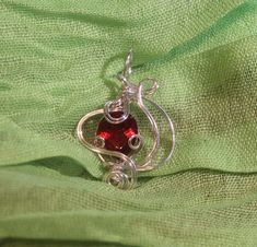 So much fire in a petite Sapphire. Gemstone: Red SapphireSize: cts 4 X 6 mmWire: Fine SilverPendant Size: X inches Belly Button Rings, Sapphire, Gemstones, Red, Jewelry, Jewlery, Bijoux, Schmuck, Jewerly
