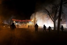 Protesters run away after police deployed tear gas during a demonstration on Nov. 24, in Ferguson, Missouri, after a St. Louis County grand jury decided not to indict Ferguson Police Officer Darren Wilson in the shooting of Michael Brown, which sparked riots in August. Justin Sullivan / Getty Images