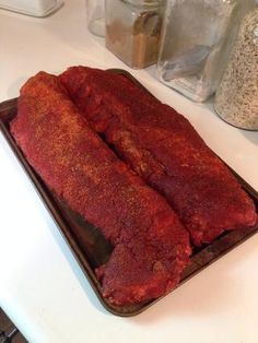 Once the ribs are completely coated, place on a baking tray or aluminum pan