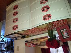 Stenciled dresser. I like the idea of the top and around e knobs being coordinated.
