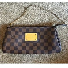 Louis Vuitton damier ebene Eva In good used condition, no rips or tears. Minor scratches on metal plate and zipper pull. Inside has wear but no major stains. Smoke free, pet free home. No odors. Please look at pic! Sorry I do not have the longer strap, only the bag and dustbag. Very cute bag!!! I do not trade‼️Made in France. Louis Vuitton Bags Clutches & Wristlets