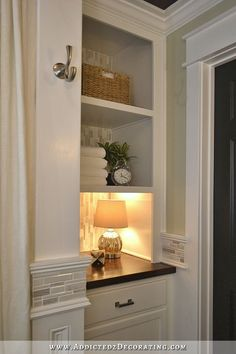 bathroom linen closet replaced with cabinet on bottom and open shelves on top