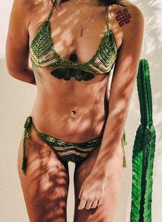 The Chevron Bikini Top features bold arrow detailing in burnt gold nestled among green tread in cotton for a playful, sexy design. Subtle crochet pattern in this Top lend a feminine vibe to the look of this Set, while the soft, smooth cotton of each piece gives the Set a luxurious feel.