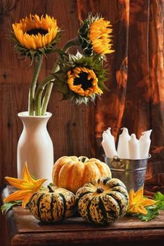 Pumpkins, orange blooms and candles as wedding decor #fall #wedding #decor #pumpkins #centerpiece
