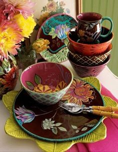 I love the combination of Brown and Bright Colours in this mismatched Dinnerware.