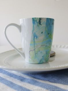 This Etceteras Marbled Coffee Cup from Carolyn's Homework uses nail polish to create the marble technique and it is so easy.