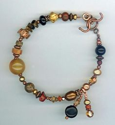 Artisan Gemstone Copper Bracelet  Such a beautiful mix of gemstone. Carnelian,, Apple Jasper, Onzx, Copper Freshwater Pearls, Garnet, Tiger Eye, ... and so much more. Artistic wire-wrapped charms add just the touch of whimsy every girl loves! The copper is mixed with Swarovski crystals to really make this a special bracelet for Fall.