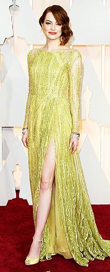 Gilded queen! Stone dazzled in a gold Elie Saab gown and Tiffany & Co. jewelry.