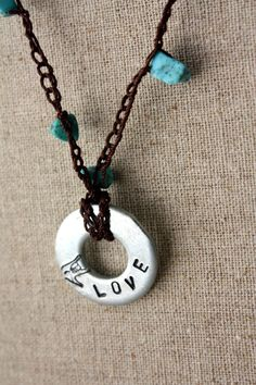 """Sign Language """"LOVE""""  necklace with turquoise beads made in Honduras. Love the necklace, and it supports Deaf in Honduras!"""
