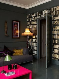 Love this bookshelf-wall!  And the slate grey paint - so dramatic and soothing.