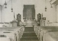 Ridge Valley Reformed United Church of Christ interior from 1947. After World War 2 the interior was updated and the main aisle was changed to the center.  The east windows were covered with hymn boards until the early 80's when the woodwork was painted white and the interior lightened up.