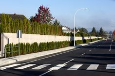 Concrete is an effective barrier to noise and wind | Duracrete Concrete Fence Products Inc.