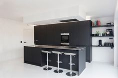 Matte black kitchen with stainless steel countertop on white pu floor. Love it!