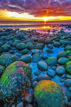 Sunset on the colorful beach of Hvaleyri, near Hafnarfjörður , Iceland