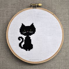 A sweet little black cat cross stitch design that you could also make in any colour(s) you desired. #cross_stitch #stitchery #crafts #cat #cute #kitty