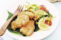 Fish in coconut batter with green mango salad. A fresh Asian twist on fish and chips.