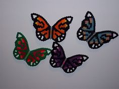 I was a happy camper when I received the butterfly pegboard that I made these guys. The purple one is the color scheme that my mother chose while the blue one in the upper right hand corner glows in the dark. I was just goofing off with Christmas colors with the butterfly outlined in green.