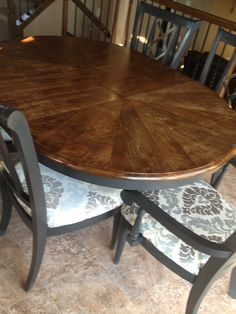 Re-stained walnut top, Annie Sloan chalk paint in graphite and reupholstered chair cushions!