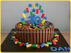 Cake: Chocolate mud Filling: Chocolate ganache Finish: Milk chocolate Kit-Kats over chocolate ganache Decoration: Hand made stars & lego bricks. All edible except for wires. Lego Themed Party, Lego Birthday Party, 6th Birthday Parties, Cake Birthday, Birthday Ideas, Chocolate Lego, Chocolate Ganache, Bolo Lego, Pistachio Cake