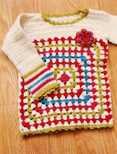 [Free Pattern] This Baby Pullover Is The Prettiest Granny Square Baby Sweater Ever!