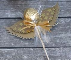 These DIY angel ornaments come together with unlikely materials, like sea glass and yarn, and look absolutely heavenly hanging on your Christmas tree. Take a look at the best angel ornaments right here. Candy Crafts, Christmas Crafts, Christmas Decorations, Paper Crafts, Christmas Ornaments, Diy Crafts, Christmas Favors, Christmas Ideas, Ferrero Rocher Gift