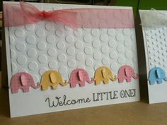 baby card - girl version - using elephant punch (alternating colors), dry embossed background, sheer ribbon.