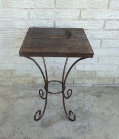Most awesome end table ever. Reclaimed barn wood and wrought iron. Perfect Small Table Plant Stand  by MakingMidCenturyMod, $69.00