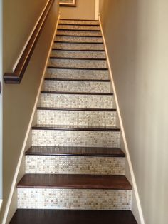 I saw this great feature in a model home. Tile on the risers of stairs. This adds awesome detail to something that is usually overlooked