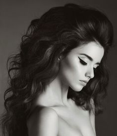 Blown out hair style curled. Love this look. makes her beautiful face standout. Keep your face wrinkle free with neutratone.com anti aging cream.