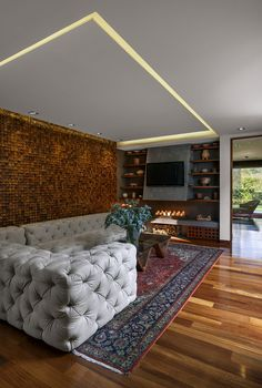 Stunning living room with accent wall that adds textural beauty