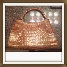 100% Authentic Brahmin Metallic Melbourne Bag Small authentic Brahmin handbag. Measurements: 7 x 11.8 in.  Strap drops about 5 inches. No stains, no signs of wear. Make an offer :) Brahmin Bags