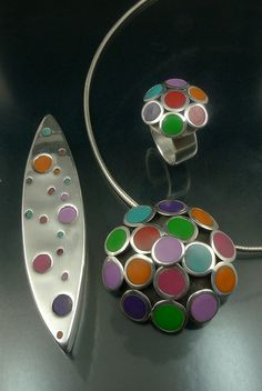I love the idea of combining the two. The polymer clay adds so much colour to the metal clay!  Lesley Messam - polymer clay + silver