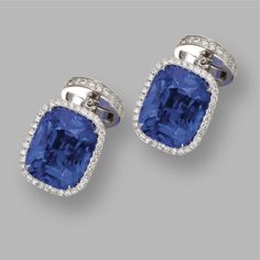 PAIR OF SAPPHIRE AND DIAMOND CUFFLINKS, JACOB & CO. Set with 2 cushion-shaped sapphires weighing 9.86 and 9.59 carats, within diamond-set frames, the opposing terminals designed as buttons pavé-set with round sapphires and diamonds, the total diamond weight approximately 2.35 carats, mounted in platinum, signed Jacob & Co., numbered 90813976. With signed box.