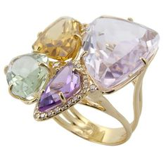 Amethyst ring - This elegant ring is accentuated by one precious pink Amethyst and one purple Amethyst; one yellow light Citrine and one Prazolite. Set in 18k yellow Gold 7.3g. Total carat weight of Diamond, 0ct.Total carat weight of 4 gemstones, 29.05ct. •$5,830.00 ||Rasko.com