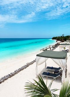A short walk away, guests have access to reserved seating and butlers on the white sand beach. #Zanzibar