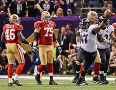 Baltimore Ravens defensive end Arthur Jones (97) reacts after recovering a fumble as San Francisco 49ers tight end Delanie Walker (46) and guard Alex Boone
