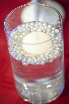 Centerpieces floating candles and pearls in a vase