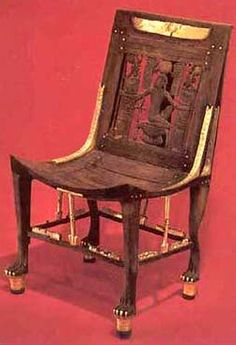 From the Tomb of Tutankhamun, a carved Chair with the god Heh, made of cedar from Lebanon